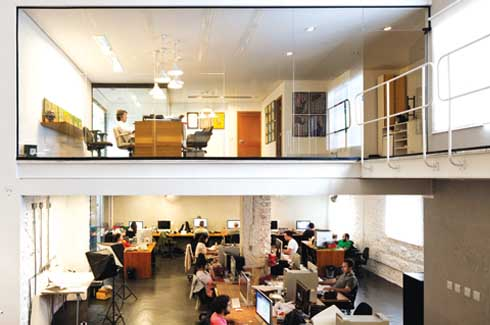 Most of the studio space enjoys a two-floor high ceiling with only a part of it sacrificed to accommodate the director's office