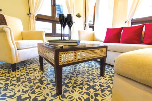 Teak furniture gets a vintage look with a touch of cane reminiscent of old-Bombay homes.