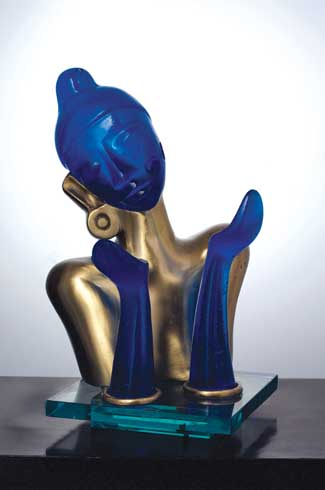 ord Krishna sits in a pensive mood. The visual juxtaposition of the blue glass and the brass, adds a dimension of elegance and identity.
