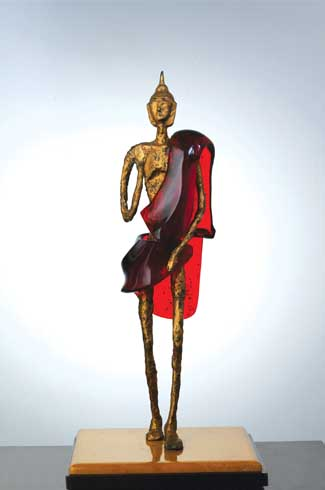 Uma's favourite piece and ours too! This bronze Buddha with a red drape is exquisitely carved and rendered with all its (im)perfections.