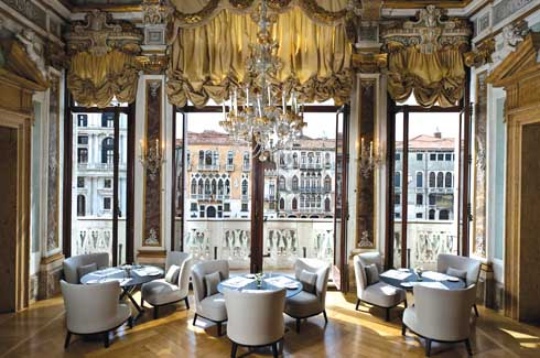 The Yellow Dining Room that opens onto the Grand Canal has frescoes by Cesare Rotta.