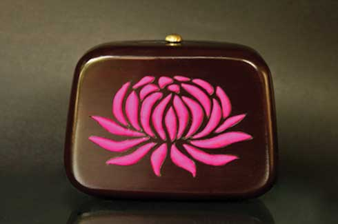 Padma Padma was the first wooden clutch designed by  Rachana Design Studio