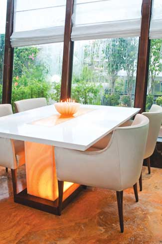Honey onyx table supports combined with creative lighting give a whimsical effect to the entire space.