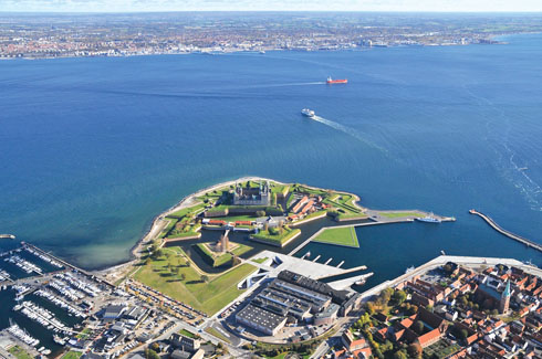 The spatial drama of the angular lines reflected in the aerial view of the museum with the Kronborg Castle  in the backdrop
