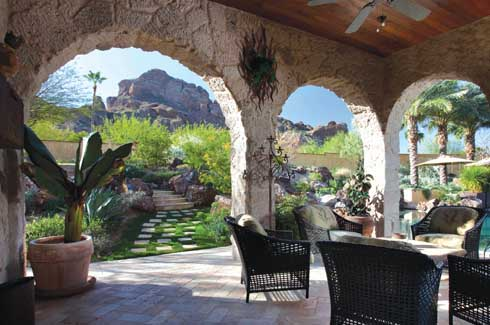The shaded patio with its comfortable furniture is an example of bringing the indoors outside. The layered garden, with its stunning  centrepiece - Camelback  Mountain - invites exploration all through the day.