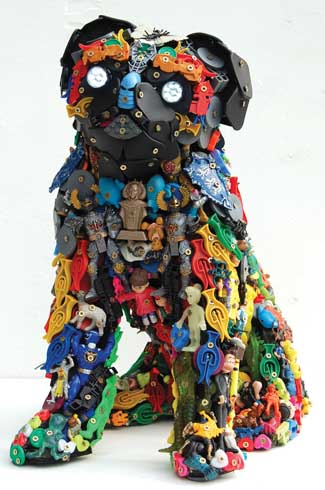 Many of the doggie sculptures are commissions by pet lovers who want a toy likeness of their pets and the finished sculpture often contains several of their old toys as well.