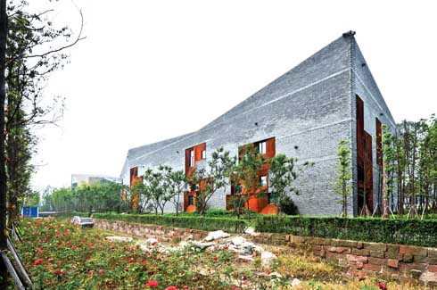 The detailed usage of the locally produced grey bricks has added substance to the structure while brilliantly supporting the geometries of the building.