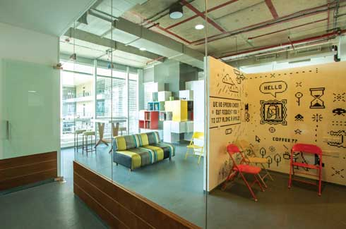 The spaces walled in glass allow a constant visual connection. Doodles and bright colours lend a casual and inspiring appeal to the work spaces.
