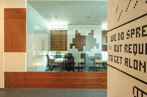 The client desired the office to be themed on eight bit games from the 80s and hence the motif of the pixel became the guiding principle for the design of this office space. This is seen within the graphics and writings on the wall, all of which are inspired by the computer architecture from that era.