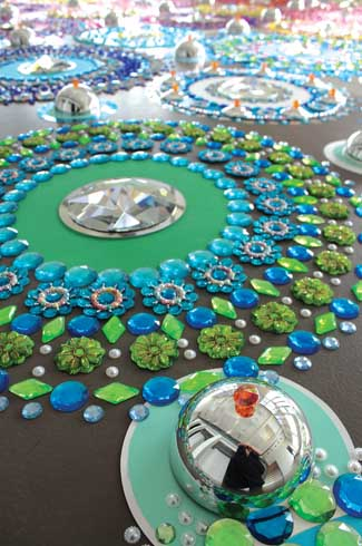 Rangoli-meets-Vegas in these floor installations composed of thousands of crystals, semi-precious stones, mirrors and other reflective surfaces.