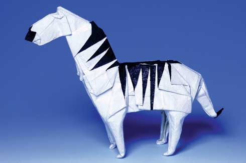 This lovely black and white zebra is part of Montroll's creative Origami Inside-Out series made by using two-coloured paper.
