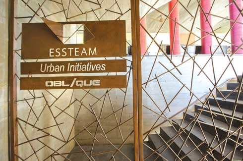 Another waste management project that is almost art - the unusable pieces of reinforcement steel were welded into an artistic mesh to become the staircase railing and the entrance door to the office.