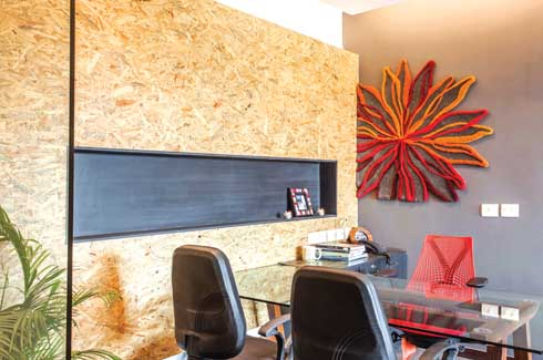 In a league of its own, this office takes delight in the surprised expressions of first-time visitors who step closer for a second look at the upcycled barstools or the rubber chappal settee.