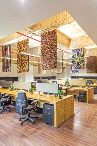 Rugs on the floor, ceiling and wall cleverly showcase the client's product range and creativity.