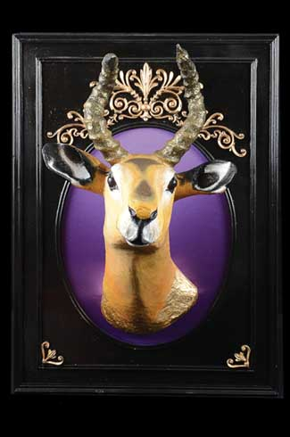 For Isabelle the deer, Maun used purple silk and gold work on the background to make it relevant to the particular taste of the region it was headed to, in this case Egypt.