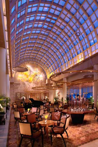 Guests can dine in the Chihuly Lounge named after famed American glass artist Dale Chihuly, under an iridescent glass-domed roof.