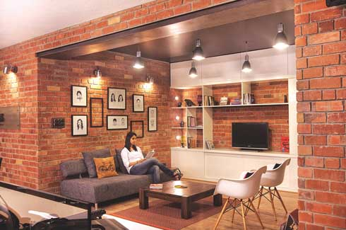 This lounge opens onto a large sit-out that faces the road. As the company expands, this area can easily be converted into a stand-alone workspace to house related facilities.