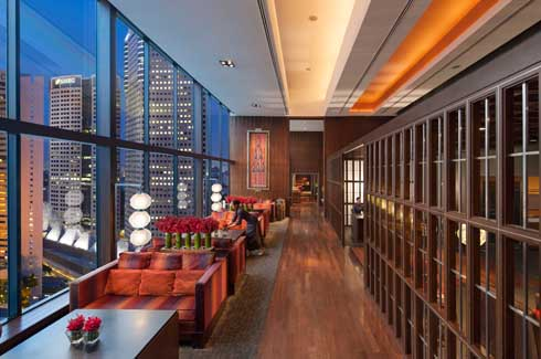 Boasting panoramic views of the city skyline, 481 square meter Oriental Club Lounge was  re-designed in a contemporary style mixed seamlessly with Oriental design accents.