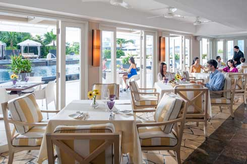 Dolce Vita oozing Italian charm with its open kitchen, floor-to-ceiling glass windows, stone-flagged floor, wooden dining chairs and panels in vivid Mediterranean colours.