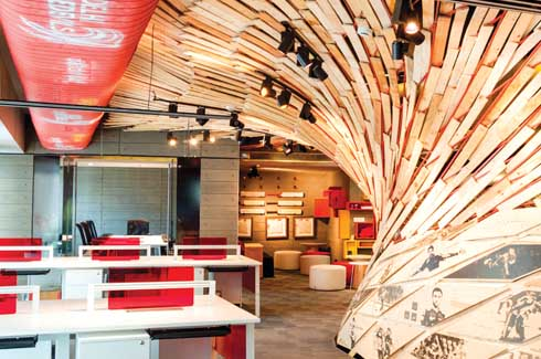 The team branding happens all through the design quite effortlessly - on the exposed air conditioning ducts, along the swirling cloud installation and on the various surfaces and furnishings.