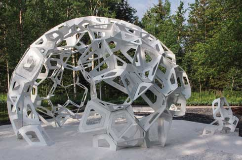 Designed like a docked and unfinished ship, the sculptural shape is reminiscent of plant cells and stores seeds of one of the 35 different plant species native to the Quebec region.