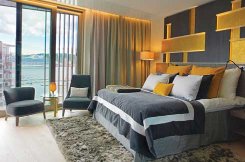 This particular guest room elegantly decorated and fitted with every de rigeur amenity has one more feather in its cap: the tantalising view of the quay with its sleek luxury liners, the sight of which can keep one hooked for hours.