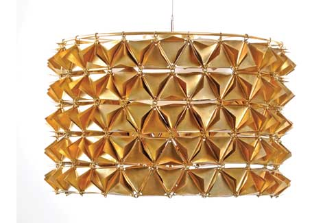 Brass Chandelier This faceted light is a tactile and sensory experience of  using traditional materials in a tessellated geometrical form