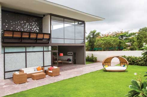 Sliding doors open the living room to the garden outside making it all one big seamless space.