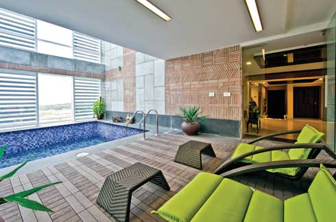 The house breathes through its double height pool area which includes a bar overlooking the pool.