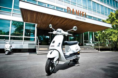 The Vespa bikes in the parking add to the style quotient of the hotel.