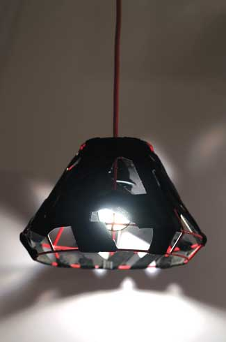 Black Wrap  This lamp uses a concept of wrapping black fabric and with a red frame
