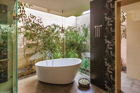 The attached garden not only adds character to the bathroom making the space look bigger but also brings the outside in effortlessly.