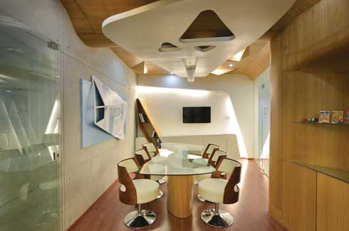 The conference room too features a unique ceiling and the over all structure highlights the flexibility of the fluid design.