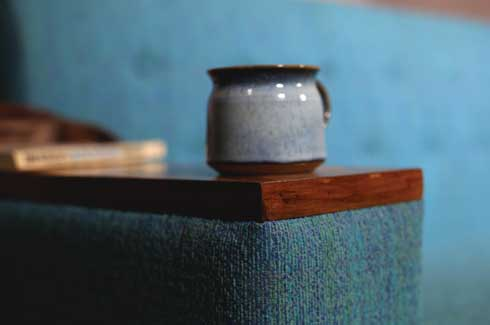 Blue Winter Chester Sofa The arm rests are finished with wood on top which doubles up as side tables to place a hot cup of tea