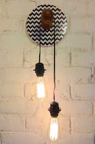 Chevron Light A regular curtain rod holder, a retro chevron print and an Edison bulb soulfully light up a space