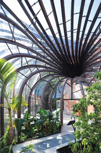 The two intertwining glasshouses are actually greenhouses that grow ten tropical and Mediterranean plants along with a hundred other plant species.