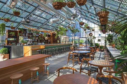 The spirit of LA is captured beautifully in this greenhouse-inspired restaurant with its naturally illuminated interiors and ample greenery.