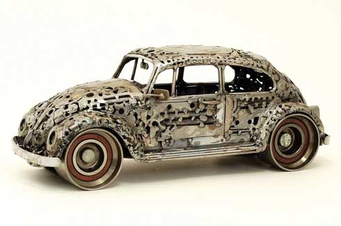A miniature model of a Volkswagen beetle car: an example of a unique blend of ingenuity  and artistry.