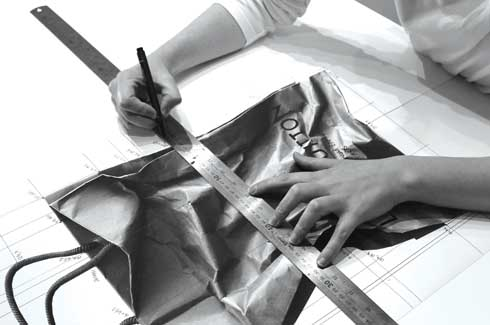 Translating a photo into drawing involves creation of grids on a large sheet of Arches paper.