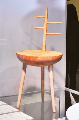 "Iktar An accent chair, Iktar derives inspiration from  ""Ektara"" a single-string instrument"