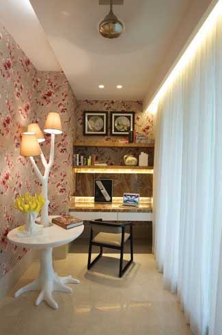 A quirky set of accessories and elegant wallpaper enhance the style quotient of this space.
