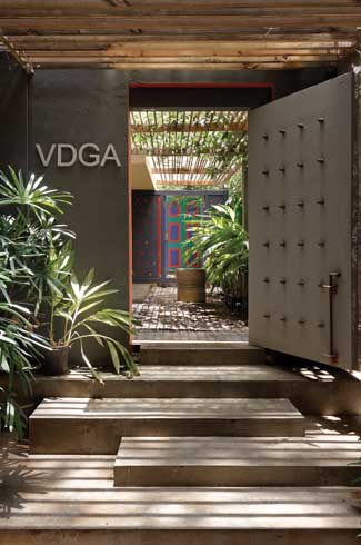 Deepak Guggari, VDGA Studio, dark wooden furniture, IPS benches, kota floors