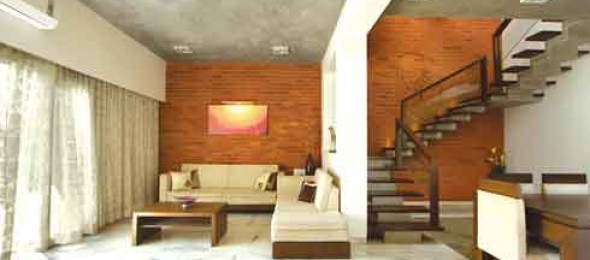 Urvi Shah Associates, Vadodara, contemporary home, brick walls, marble, kota stone, wooden furniture .