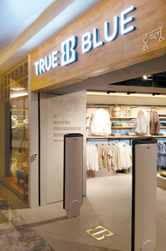 True Blue Store, Mumbai, I-AM, Indian jaali, arches, columns, heritage-inspired interiors.