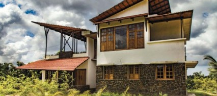 The Azeez Residence, De Earth, Calicut, Kerala, plastered surface, Vivek and Nishan, pebble yard, unique, rustic, eco friendly.