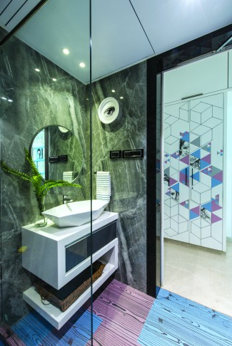 Gaurav Kharkar, Jain penthouse, MS skeleton, beige Bellissimo, Statuario marble, walk-in-wardrobe, Sufficient highlighting, pop of colour, seamless integration of art.