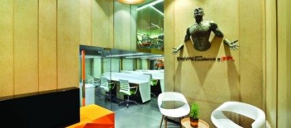 Icon Projects, commercial office space, Amit Porwal, attached terrace, a double-height ceiling, multi-functional modular room, mezzanine, futuristic look, White cubicles, grey flooring.